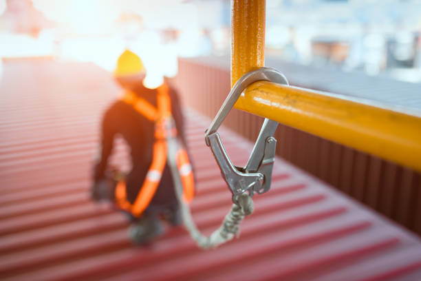 Construction worker wearing safety harness and safety line stock photo