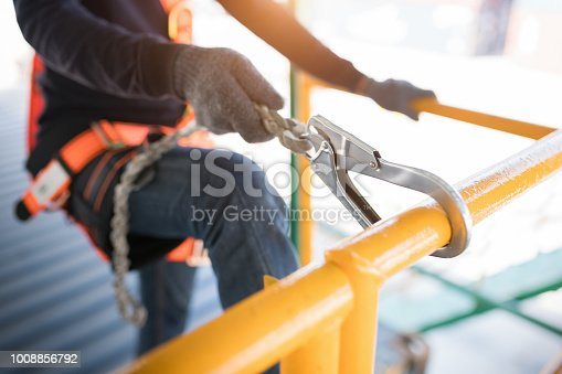 istock Construction worker wearing safety harness and safety line 1008856792