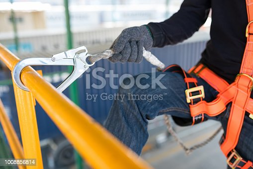 istock Construction worker wearing safety harness and safety line 1008856814