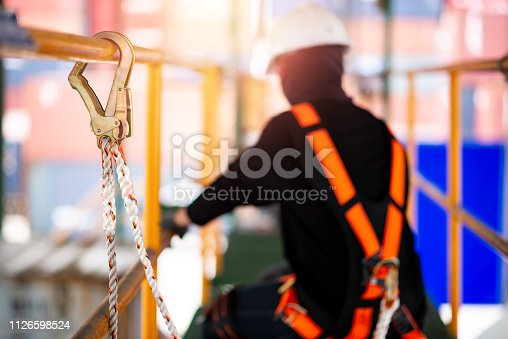 istock Construction worker wearing safety harness 1126598524