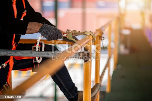 istock Construction worker wearing safety harness 1140082068