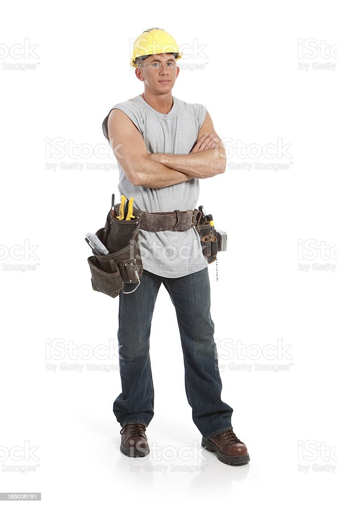 Construction Worker Wearing Tool Belt and Hard Hat stock photo