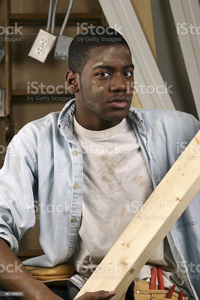 Construction Worker with 2x4 stock photo
