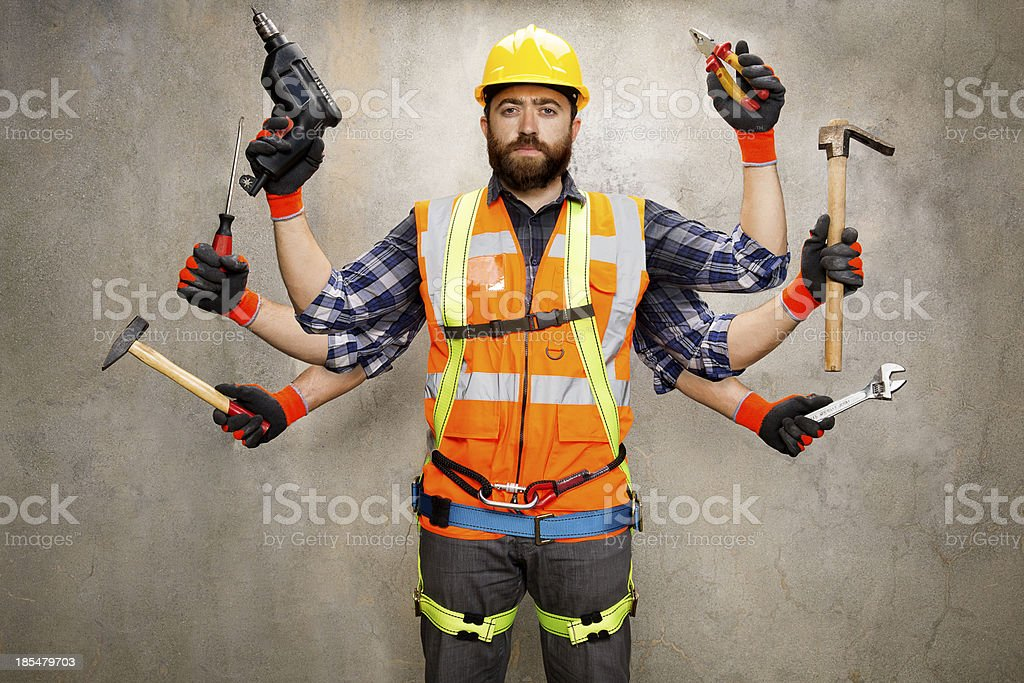 Construction Worker with 6 Arms stock photo