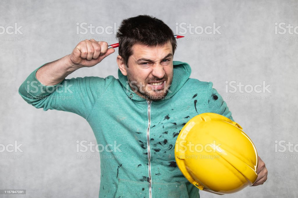 construction worker with a nail in his head, accident during work