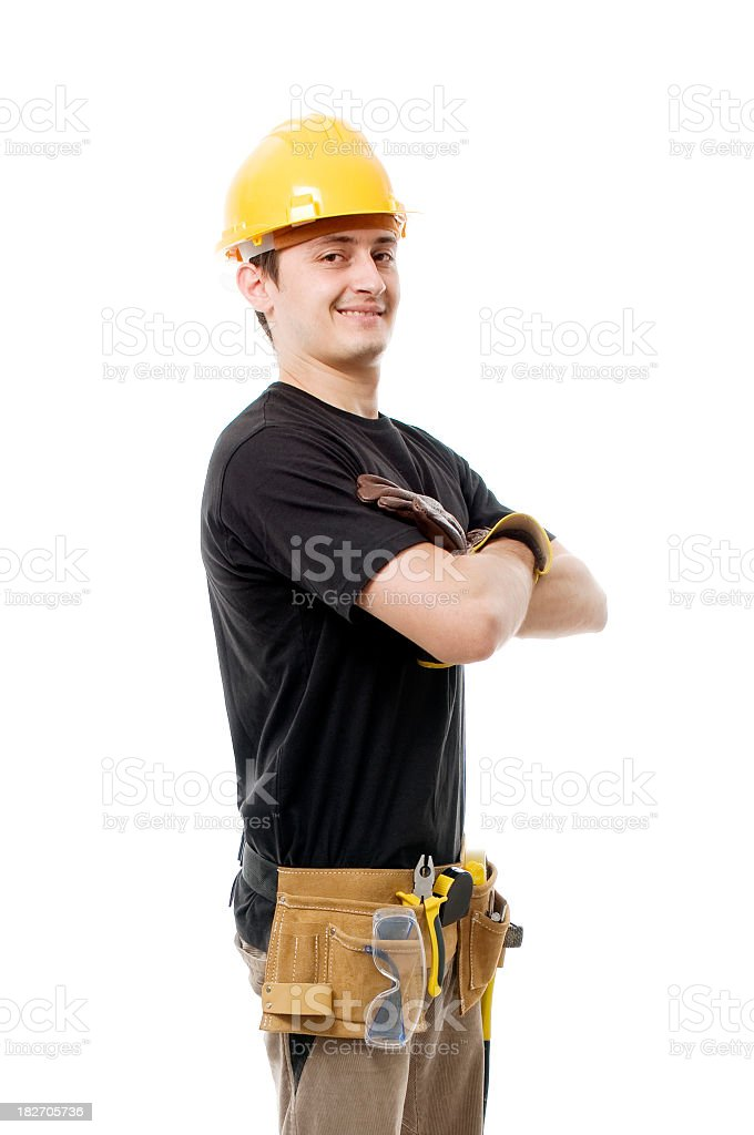 Construction worker with arms crossed, smiling royalty-free stock photo