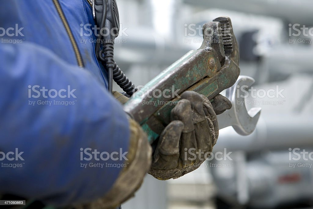 construction worker with big wrench stock photo