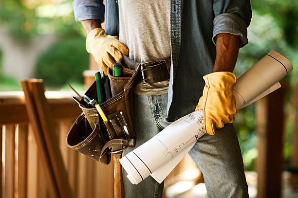 construction worker with blueprints and tool belt - tool belt stock photos and pictures