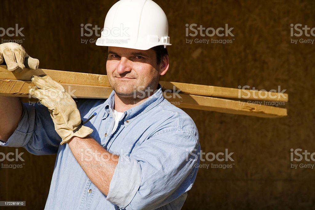 Construction Worker with Building Materials royalty-free stock photo