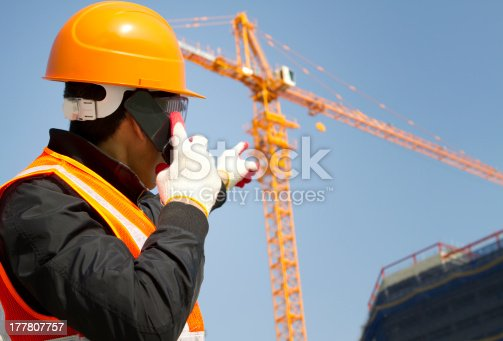 istock construction worker with crane in background 177807757