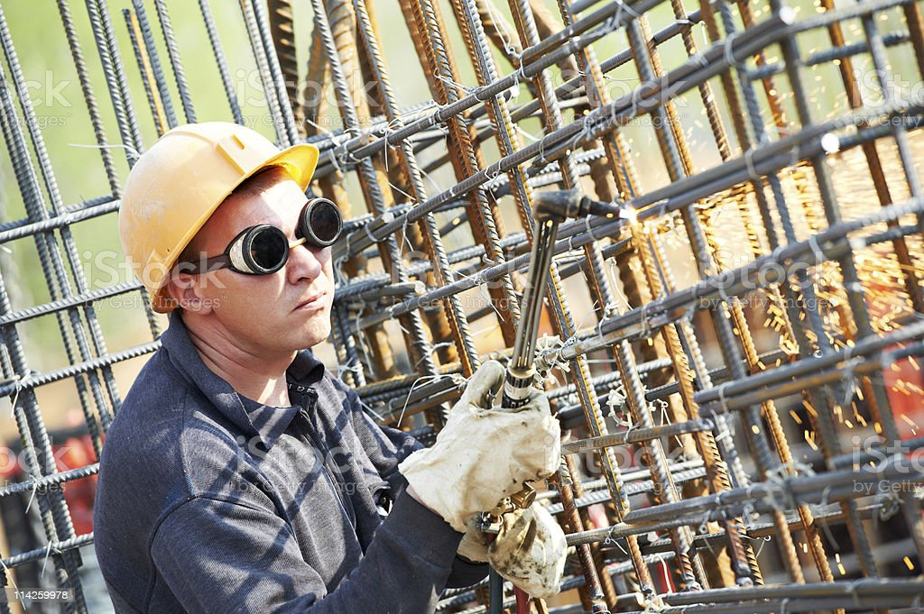 construction worker with flame cutting equipment stock photo
