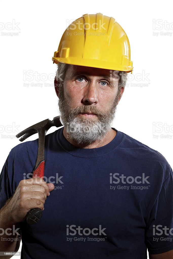 Construction worker with hammer and hardhat isolated on white background royalty-free stock photo