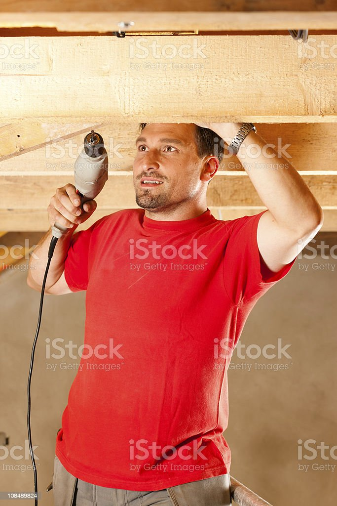 Construction worker with hand drill royalty-free stock photo