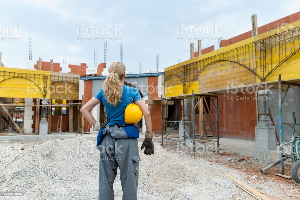 Construction worker with hardhat in hand stock photo