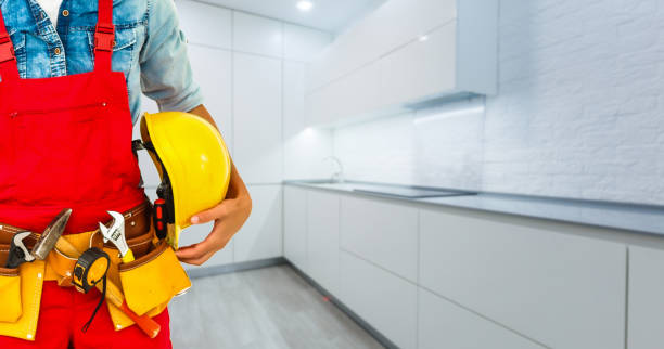 Construction worker with helmet and tool belt. stock photo