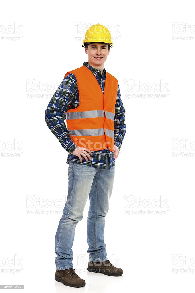 Construction worker with orange vest and yellow hat smiling stock photo