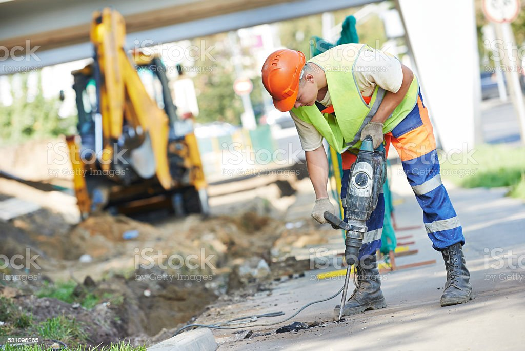 construction worker with perforator stock photo