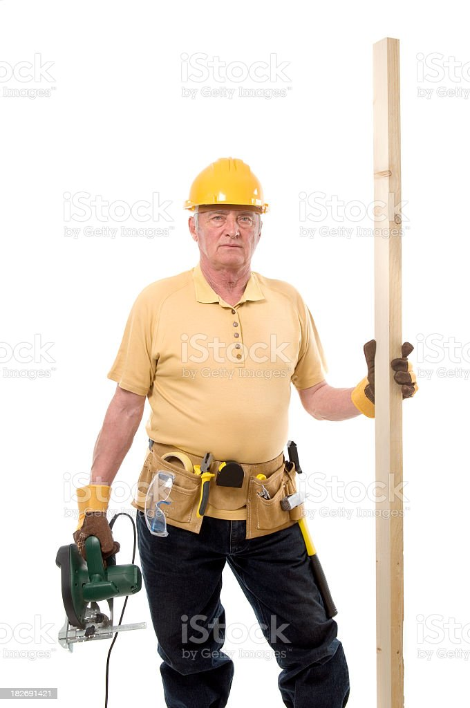 Construction worker with saw and wood royalty-free stock photo