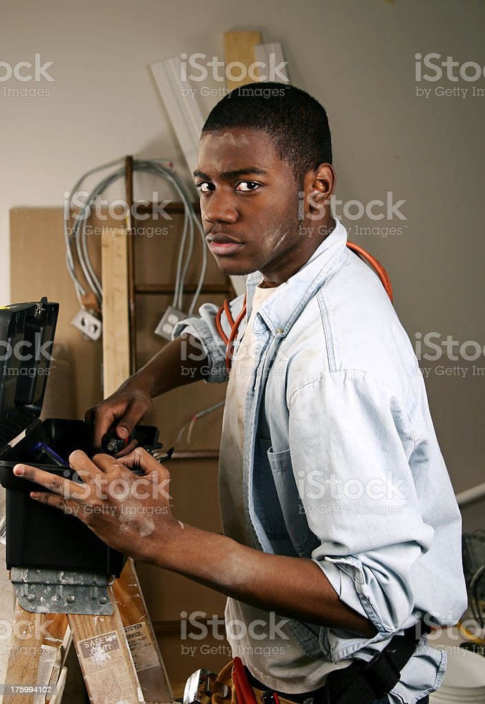 Construction Worker with Toolbox stock photo