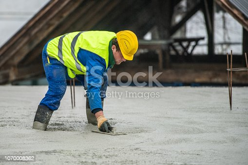 istock Construction worker working at construction site 1070008362