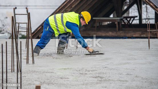 istock Construction worker working at construction site 1070008374