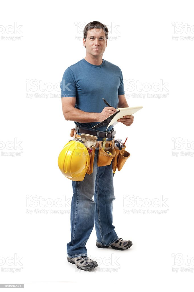 Construction worker writing on a clipboard royalty-free stock photo