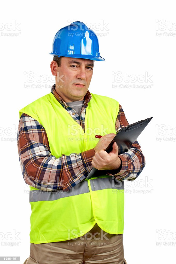 Construction worker writing royalty-free stock photo