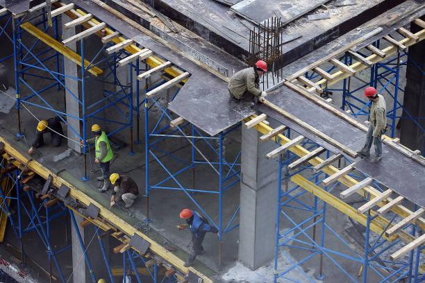 Architectes et ouvriers du bâtiment en vue d'en haut - Photo