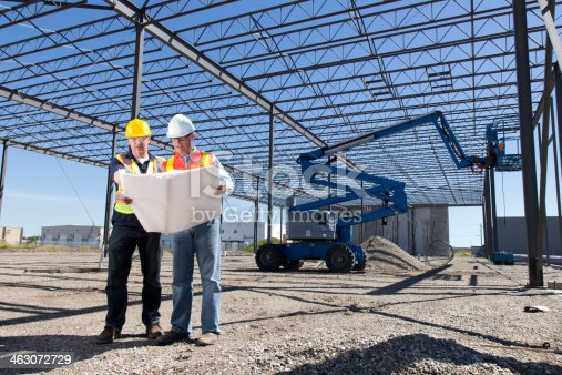 istock Construction Workers and Steel Frame Building 463072729
