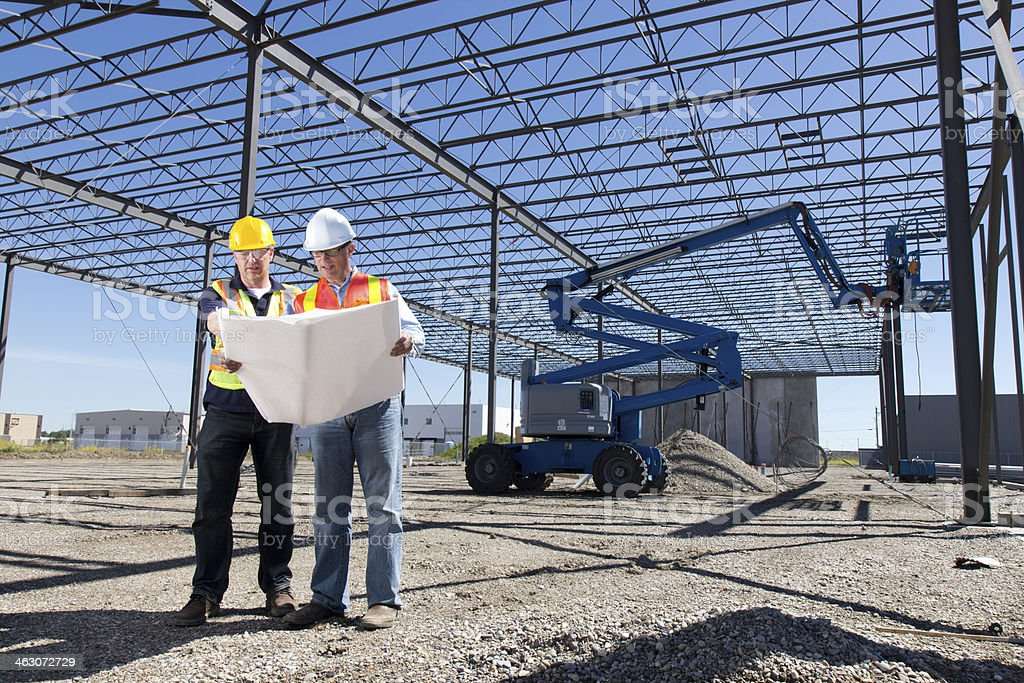 Construction Workers and Steel Frame Building stock photo