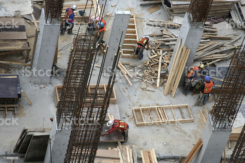 Construction workers at a job site stock photo