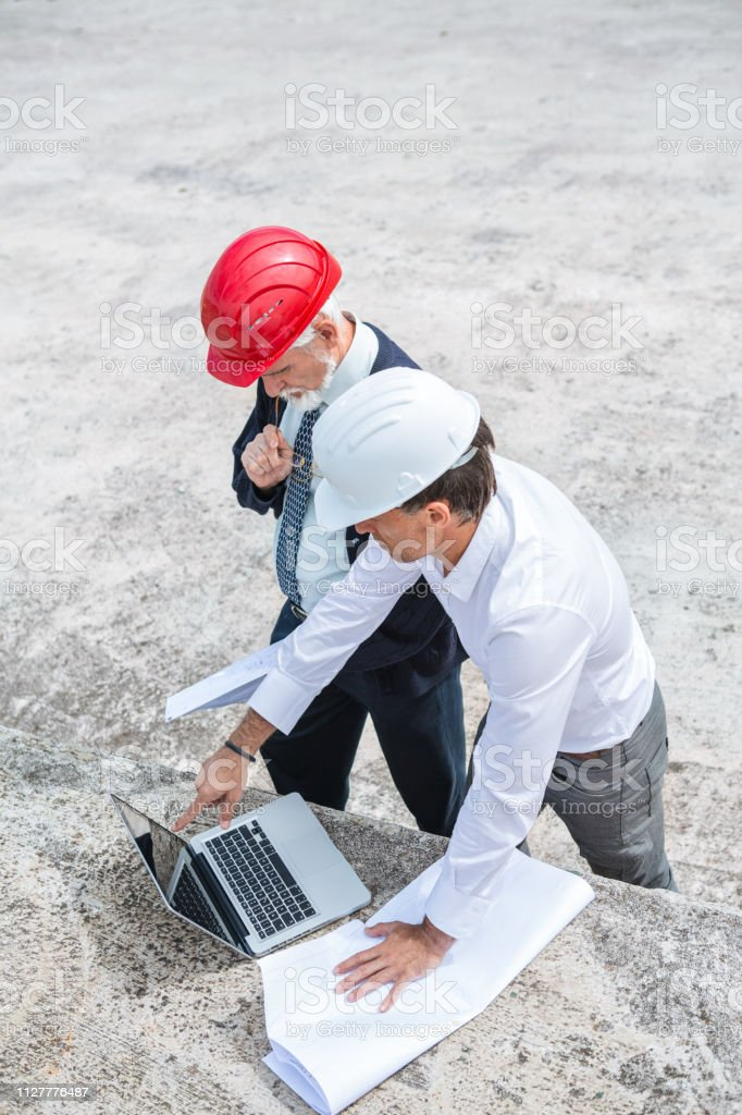 Construction Workers At Commercial Dock stock photo