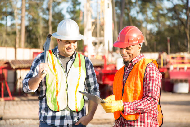 Construction workers at outdoor drilling site. stock photo