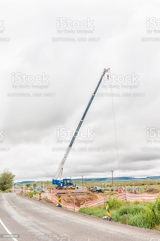 Construction workers building a new bridge stock photo
