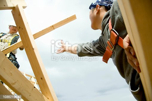 Construction workers building house