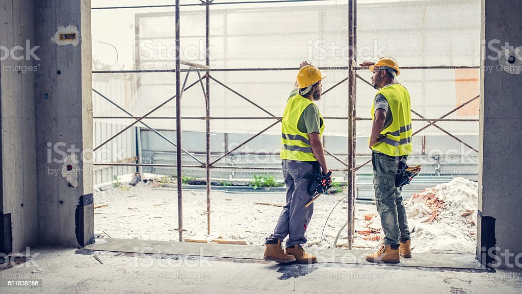 Construction workers discussing stock photo