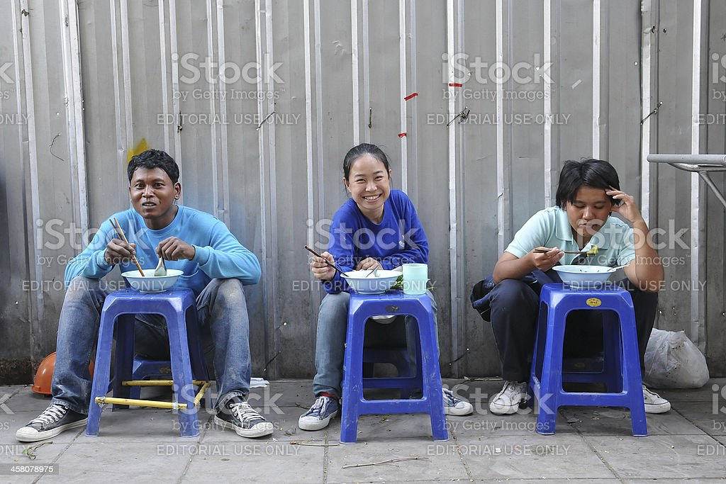 Construction Workers Eating at a Roadside Restaurant royalty-free stock photo