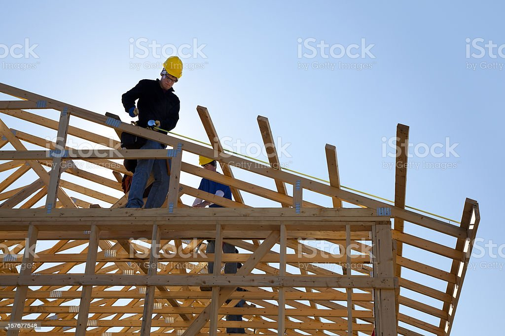 Construction Workers Framing-In Roof stock photo