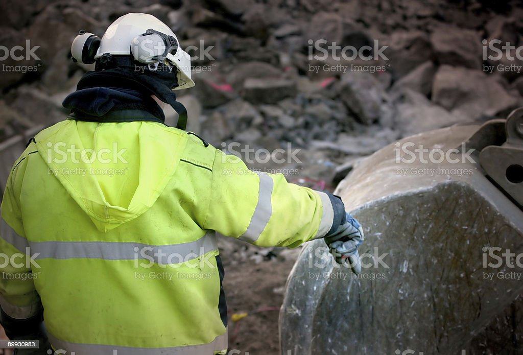 construction workers giving instruction royalty-free stock photo