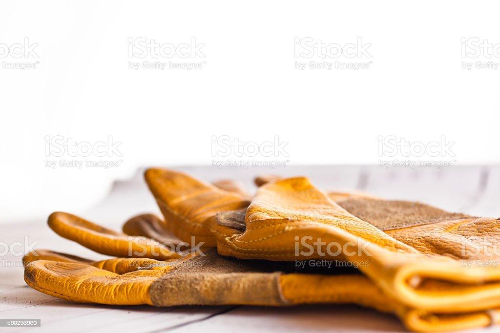 Construction worker's gloves on floorplans. Стоковые фото Стоковая фотография