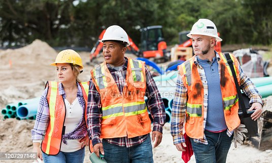 istock Construction workers going on lunch break 1207297146
