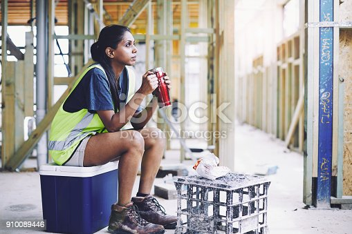 istock Construction workers in Australian in building site working and doing tasks. 910089446