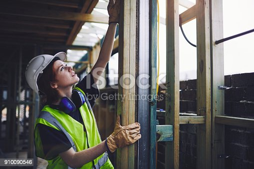 istock Construction workers in Australian in building site working and doing tasks. 910090546