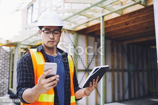 1054724700 istock photo Construction workers in Australian in building site working and doing tasks. 910091458