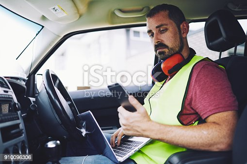 1054724700 istock photo Construction workers in Australian in building site working and doing tasks. 910096306