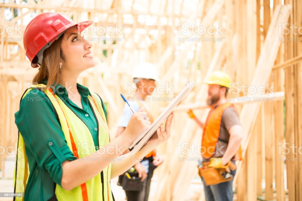 Construction workers in building site. royalty-free stock photo