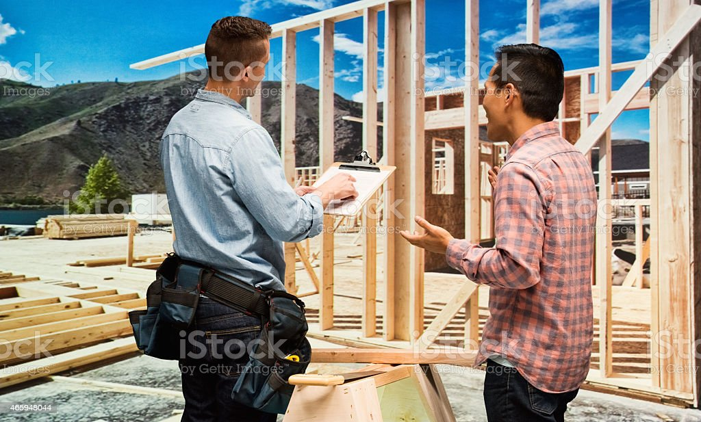 Construction workers in conversation...
