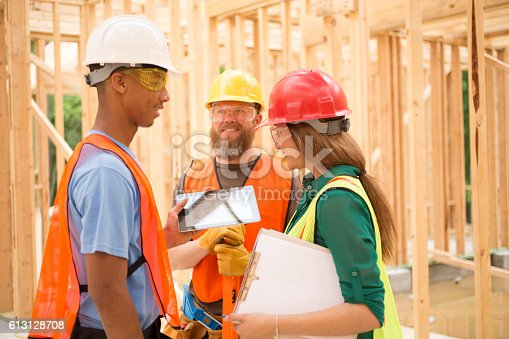 istock Construction workers inside job site using digital tablet. 613128708