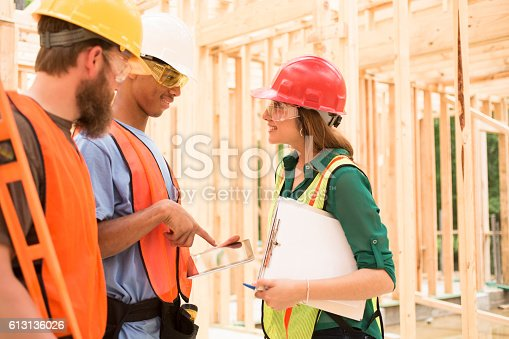 istock Construction workers inside job site using digital tablet. 613136026