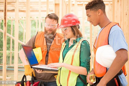 istock Construction workers inside job site with laptop. 613211796
